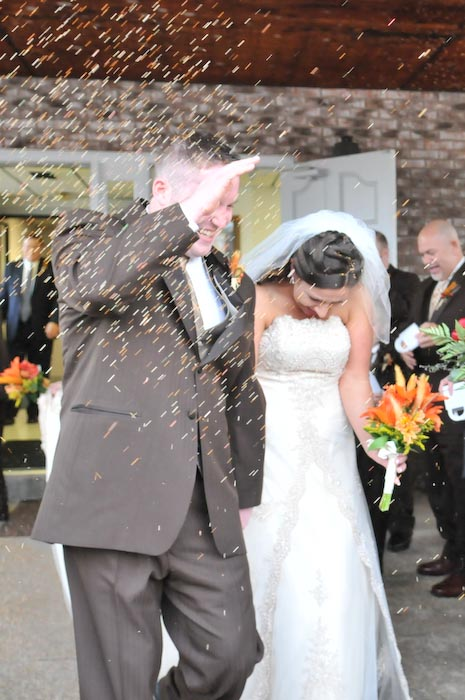 The couple's wedding guests were very enthusiastic about throwing bird seed.