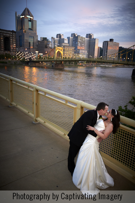 bride and groom on bridge at dusk