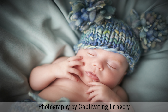baby portrait in knit wool hat
