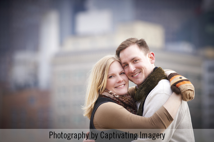 couple in front of Pittsburgh skyline