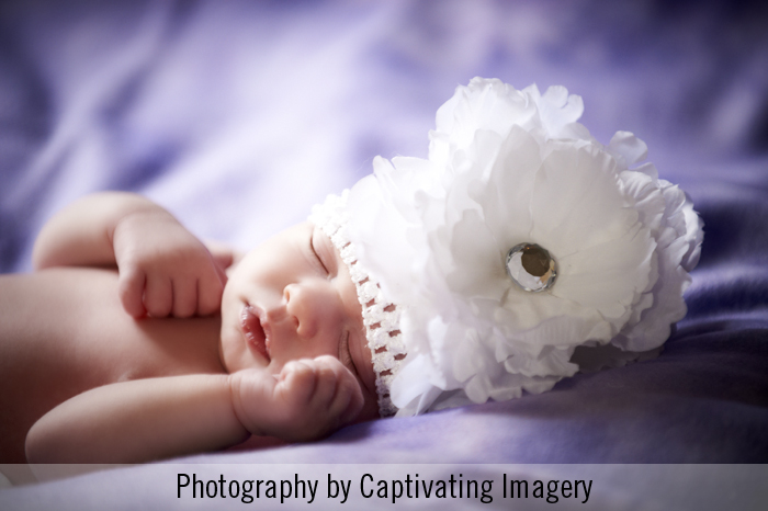 newborn in a white cap