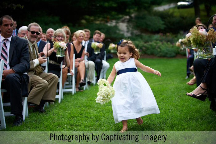 flower girl running down the aisle