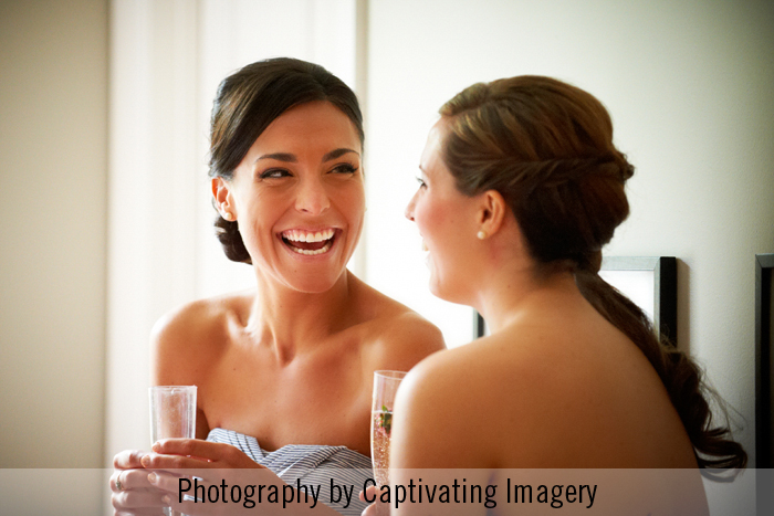 bridesmaids laughing and sipping their mimosas