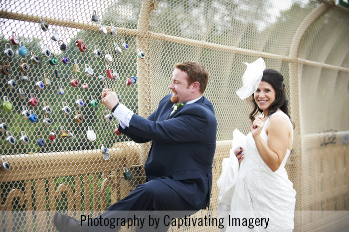 groom trying to unlock the love lock