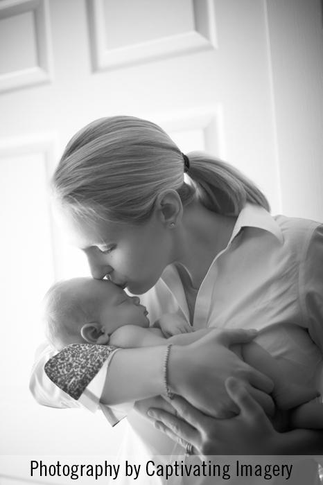 mama kissing baby