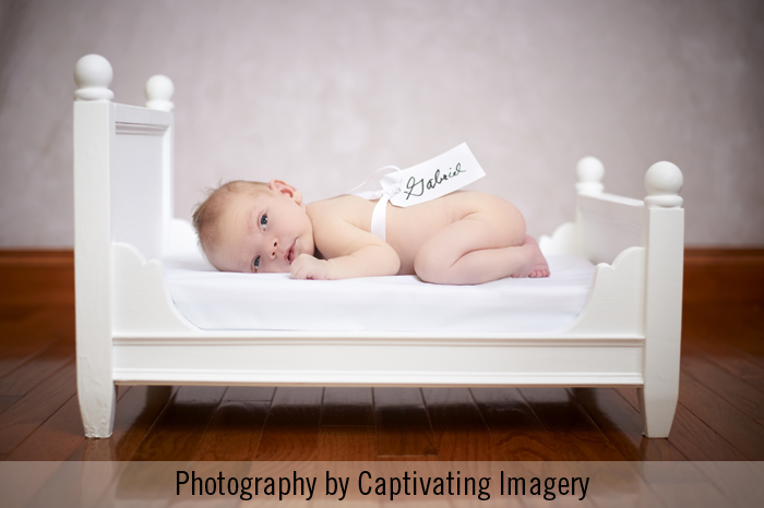 infant on small bed