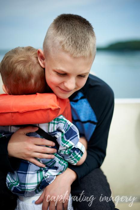 my nephew hugging my littlest
