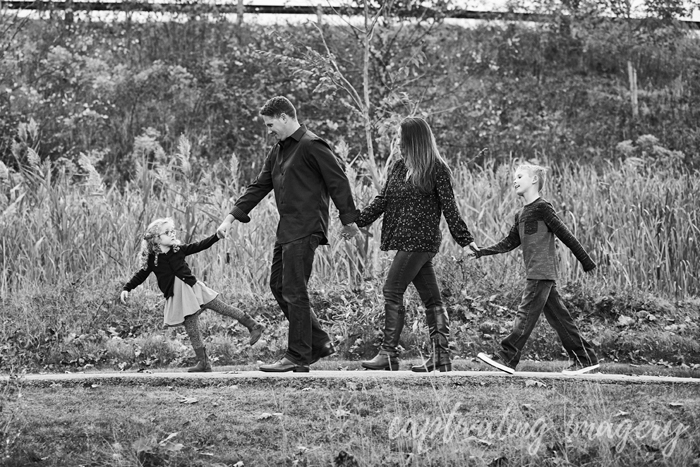 walking family holding hands