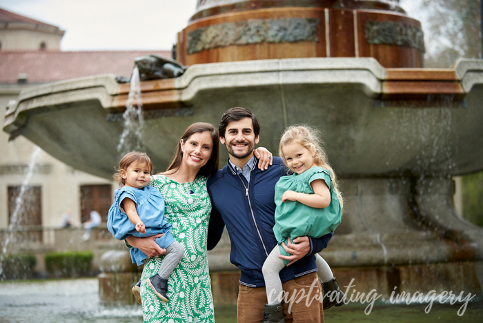 family portrait by the fountain