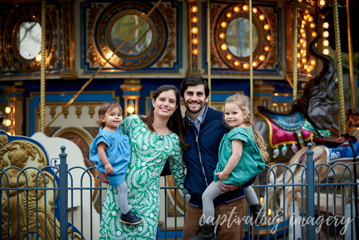 family by the carousel