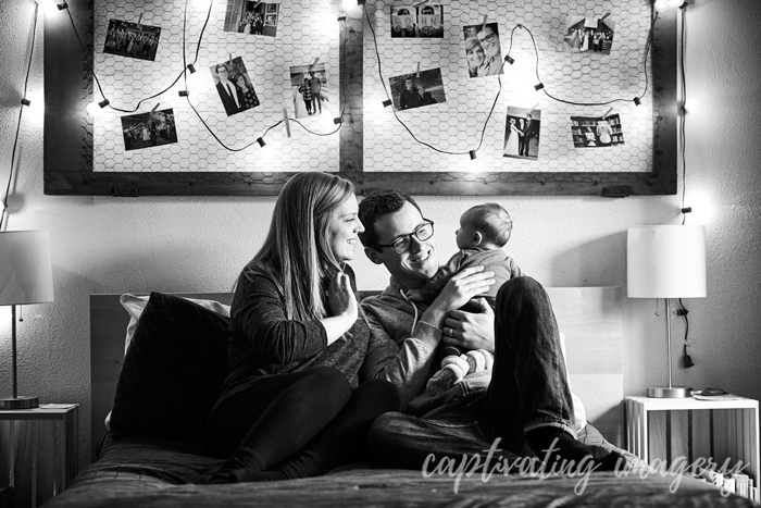 mom, dad, and baby on bed